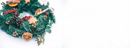 Christmas wreath isolated on a white snow background stock images