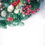 Christmas wreath isolated on a white snow background royalty free stock photos