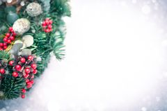 Christmas wreath isolated on a white snow background royalty free stock image