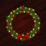 Christmas wreath with light garland and silk bow. Royalty Free Stock Images