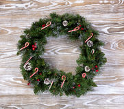 Christmas wreath with lights and candy canes on white wooden boa Royalty Free Stock Photography