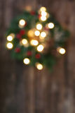 Christmas wreath with lights defocused background Stock Photo