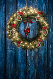 Christmas wreath. With lights and ornaments on a weathered wooden blue background Stock Photography