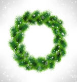 Christmas wreath like frame in snowfall on gray Stock Photo