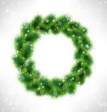 Christmas wreath like frame in snowfall on gray Stock Photo