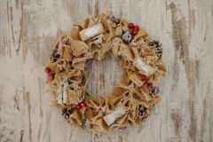 Christmas wreath made of canvas  on wooden background Stock Photo