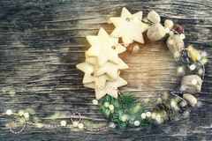 Christmas wreath made from cookies, nuts, pine cones and fir branches Stock Photo