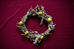 Christmas wreath made of dried twigs and lichens stock images
