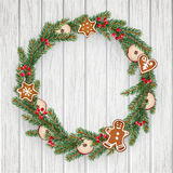 Christmas wreath made of evergreen fir, spruce branches, red berries, dried apple fruit, gingerbread cookies. Realistic  Stock Photography
