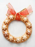 Christmas wreath made of gingerbread. Decorated shortbread cookies in the shape of Christmas wreath and stars. Top view Stock Photos