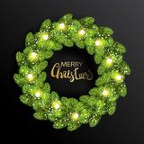 Christmas wreath made of green pine branches. With light bulbs string and shining snowfkakes. Merry Christmas lettering text. Fir tree wreath isolated on black Stock Image