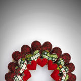 Christmas wreath made with patchwork red hearts half. Half Christmas wreath made with patchwork red and patterned hearts royalty free stock photography