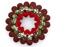 Christmas wreath made with patchwork red hearts isolated on white background Royalty Free Stock Photos