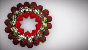 Christmas wreath made with patchwork red hearts Royalty Free Stock Photos
