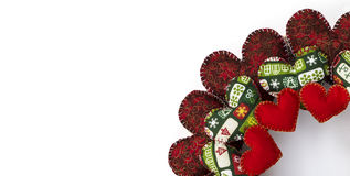 Christmas wreath made with patchwork red hearts quarter Royalty Free Stock Images
