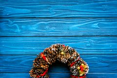 Christmas wreath made of pine cones on blue wooden background top view space for text. Christmas wreath made of pine cones on blue wooden background top view royalty free stock images