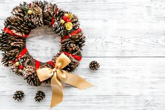 Christmas wreath made of pine cones on white wooden background top view copy space. Christmas wreath made of pine cones on white wooden background top view royalty free stock photos