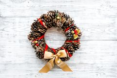 Christmas wreath made of pine cones on white wooden background top view copy space. Christmas wreath made of pine cones on white wooden background top view stock photography