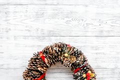Christmas wreath made of pine cones on white wooden background top view copy space. Christmas wreath made of pine cones on white wooden background top view royalty free stock images