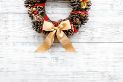 Christmas wreath made of pine cones on white wooden background top view space for text. Christmas wreath made of pine cones on white wooden background top view stock photos