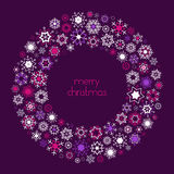 Christmas wreath made of snowflakes with Merry Christmas text. Royalty Free Stock Photography
