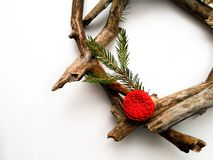 Christmas wreath closeup. Tree and fir branches. Red flower. White background. Minimalistic design stock photography