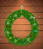Christmas wreath with New Year balls and snowflake. S, Wooden background with ray of light Stock Images