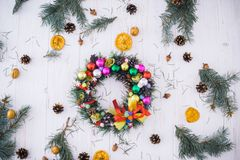 Christmas wreath with New Year`s decor on a white wooden background stock images