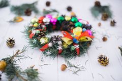 Christmas wreath with New Year`s decor on a white wooden background royalty free stock images