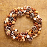 Christmas wreath with nuts, cones and cookies Stock Images