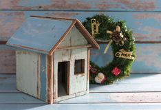 Christmas wreath and old house on grunge blue background Stock Images