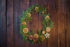 Christmas wreath on old wooden background. Christmas wreath on old dark wooden background stock photography