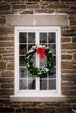Christmas Wreath On Old Window Pane Royalty Free Stock Photos