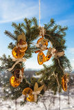 Christmas Wreath On The Blue Sky Background Royalty Free Stock Photography