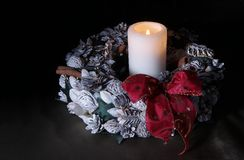 Christmas wreath with one candle Stock Photo