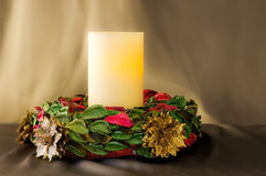 Christmas wreath with one candle Stock Images