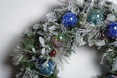 Christmas Wreath. One quarter of a frosty, decorated Christmas wreath royalty free stock image