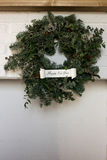 Christmas wreath over fireplace. With inscription happy new year Royalty Free Stock Photography