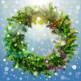 Christmas wreath with overhead lighting and snowfa Stock Photography