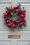 Christmas Wreath on a Pale Green Door Royalty Free Stock Photos