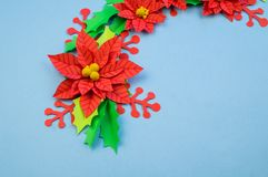 Christmas wreath of paper flowers poinsettia royalty free stock photos