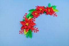 Christmas wreath of paper flowers poinsettia stock image