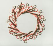 Christmas wreath pattern made from candy cane sticks and cinnamon Stock Image
