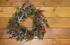Christmas wreath. From pine branches with berries and slices of ice royalty free stock photo