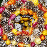 Christmas wreath with pine cones and flowers Royalty Free Stock Images