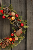 Christmas wreath with pine cones and nuts. Christmas wreath with pine cones, nuts and juniper Royalty Free Stock Images