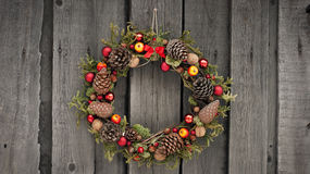 Christmas wreath with pine cones and nuts. Christmas wreath with pine cones, nuts and juniper Stock Photos