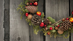 Christmas wreath with pine cones and nuts. Christmas wreath with pine cones, nuts and juniper Royalty Free Stock Photography