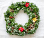 Christmas wreath. With pine cones resting on artificial snow royalty free stock image