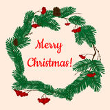Christmas wreath with pine and holly berries Royalty Free Stock Photo